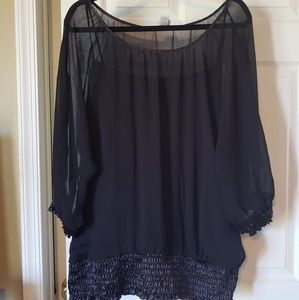 Beautiful black top with sheer outside detail